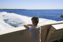 Boy seeing the sea on a boat Royalty Free Stock Photography
