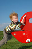 Boy on SeeSaw Royalty Free Stock Image