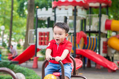 Boy on the seesaw Stock Photos