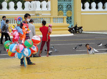 A boy sell balls on the street Royalty Free Stock Photography