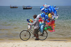 Boy selling balloons Stock Image