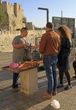 Boy is selling bread outdoor in Jerusalem, Israel Stock Photography