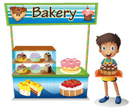 A boy selling cakes Royalty Free Stock Photography