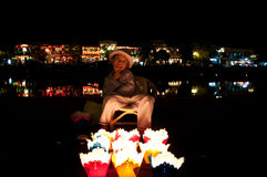 Boy selling candles in Hoi An, Vietnam. Vietnamese boy selling floating candles to tourists visiting Hoi An, Vietnam. Hoi An is an ancient town and popular Royalty Free Stock Photo