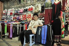 A boy selling clothes in bazza, Shiraz Iran Stock Photography