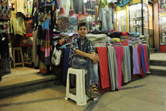 A boy selling clothes in bazza, Shiraz Iran Stock Photos