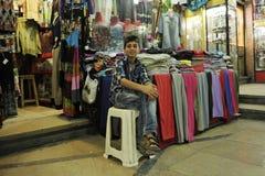 A boy selling clothes in bazza, Shiraz Iran stock photos