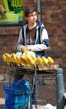 Boy selling corn at flea market Stock Photos