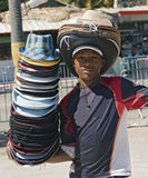 Boy Selling Hats at a Carvival Royalty Free Stock Photography