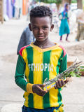 A boy selling mefakia, a natural wooden toothbrush used in Ethio Royalty Free Stock Photo