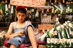 Boy selling rose water Stock Photos