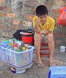 Boy sells beverages, Hanoi, Vietnam Stock Image