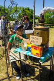 Boy sells tea from the old samovar on Strawberry festival Stock Photography