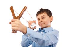 Boy sending messages on crumpled paper. Portrait of a schoolboy sending notes or messages with slingshot and a piece of crumpled paper Royalty Free Stock Photos