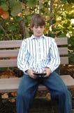 Boy sending text message royalty free stock photos