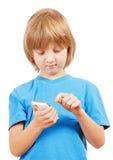 Boy Sending Text Message on Mobile Phone Stock Photos