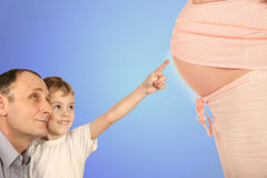 Boy with senior pointing pregnant belly collage Stock Image