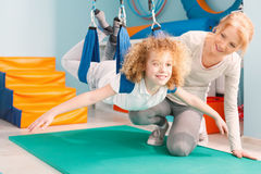 Boy during sensory integration therapy. Boy and his therapist exercising during sensory integration therapy Stock Photos