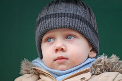 The boy is seriously. Close-up Royalty Free Stock Photo