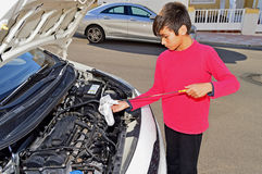 Boy Servicing A Car Royalty Free Stock Image