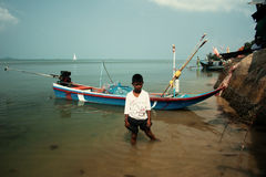 Boy in the settlement of fishermen in Thailand Stock Image