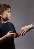 Boy shaking hand Stock Image
