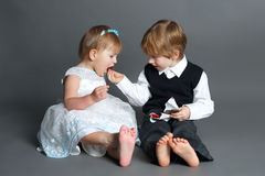 Boy shares with girl chocolate bar Stock Images