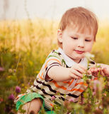 Boy sharing flowers Royalty Free Stock Photography