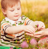Boy sharing flowers Stock Image