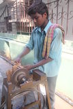 Boy sharpening knife Stock Photo