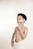 Boy and shaver Royalty Free Stock Photos
