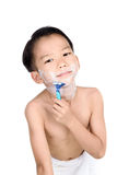 Boy and shaver. Young boy is shaving his face in the bathroom Stock Images