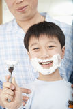 Boy With Shaving Cream on Face Royalty Free Stock Photography