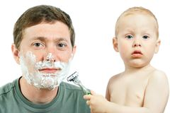 Boy shaving father Stock Photo