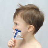 Boy shaving Royalty Free Stock Images