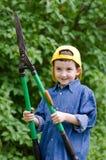 Boy with shears gardener Stock Photos