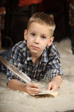 Boy with a  quill pen Royalty Free Stock Photography
