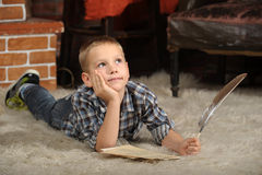 Boy with a  quill pen Stock Photography