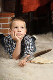 Boy with a  quill pen Royalty Free Stock Image