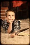 Boy with a  quill pen Stock Photos