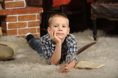 Boy with a  quill pen Stock Photo