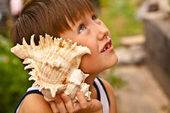 Boy with a shell Royalty Free Stock Photography