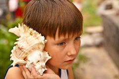 Boy with a shell Royalty Free Stock Photo