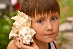 Boy with a shell Royalty Free Stock Images