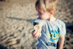 Boy and a shell royalty free stock images