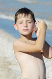 Boy with shell in hand Royalty Free Stock Photos