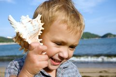 Boy.shell.sea Stock Photos