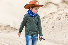 Boy in a sheriff hat royalty free stock images