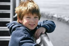 Boy on Ship. Relaxing boy on the deck of a ship Royalty Free Stock Photos