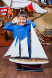 Boy with ship Stock Photos